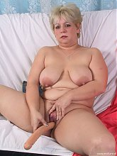 Mature chubby slut playing and sucking cock