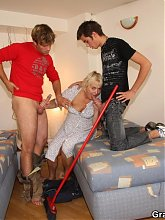 The old cleaning lady comes into their apartment and they immediately fuck her