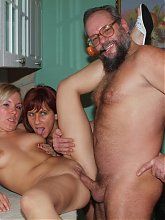 Horny mature redhead Myra Cave shares a cock with a cute blonde during a webcam session