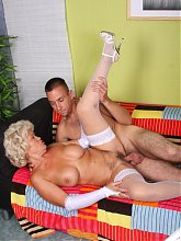 Explicit live sex show with a big boobed grandma named Francesca riding a dick on the couch