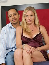 Sweet looking mature blonde Violet enjoys her first black cock during this webcam show